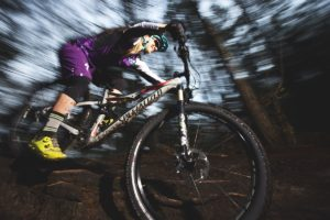 Adult mountain bike rider riding in Epping Forest